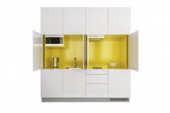 Kompletne vybavená kuchyňa typu S ukrytá v skrini s rozmermi 240 × 253 × 69 cm, pracovná doska: laminát 3,8 cm, korpusy v odtieni biela perlička a žltá (dizajn Roman Vrtiška a Vladimír Žák, Indeco)